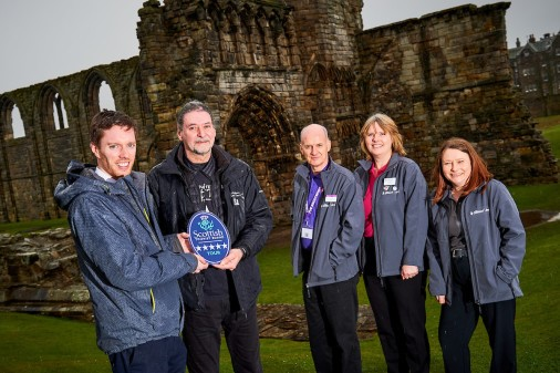 Richard Falconer, from St Andrews Ghost Tours, receives his award from VisitScotland strategic partnership executive, Neil Christison, left, and St Andrews iCentre staff, from left, Colin McKilop, Heather Holanek and Nicola Harrison.